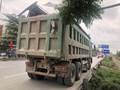 Mạnh tay xử lý xe ô tô chở vật liệu xây dựng để rơi vãi xuống đường