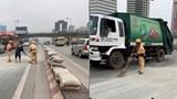 Cảnh sát giao thông dọn dẹp hơn 1 tấn xi măng rơi ra đường