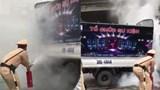 Hà Nội: Xe tải bất ngờ bốc cháy, CSGT kịp thời giúp tài xế khống chế