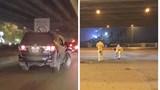 Hà Nội: Phẫn nộ ô tô đâm gục xe máy rồi bỏ chạy, nghi do xe biển xanh