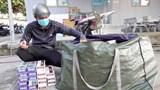 Bắt 2 đối tượng sử dụng xe mô tô vận chuyển 1.700 bao thuốc lá lậu