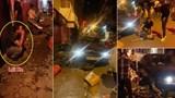 Kinh hoàng ô tô BMW tông ngã gục hàng loạt người trên phố Mai Hắc Đế