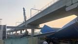 Dầm bê tông cầu bộ hành đè bẹp container tại Thủ Đức
