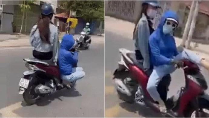"""Cô gái """"làm xiếc"""" trên xe máy"""