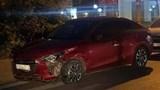 Tìm thấy ô tô Mazda màu đỏ húc văng 7 xe máy dừng chờ đèn đỏ ở Long Biên