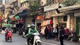 """Tài xế xe công nghệ, shipper vẫn """"lăn xả"""" trên khắp đường phố Hà Nội trong giá rét"""