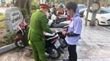 Hai bãi xe trên phố Đinh Tiên Hoàng bị xử phạt 7,5 triệu đồng