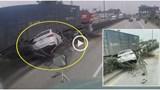 [Clip] Va chạm với xe container cùng chiều, ô tô con húc đổ dải phân cách rồi xoay 180 độ