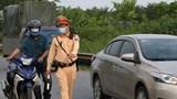 Xử lý tình trạng xe máy đi vào phần đường ô tô trên Đại lộ Thăng Long