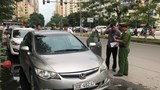 Phạt hàng loạt cửa hàng bán ô tô cũ lấn chiếm hè, đường Lê Văn Lương