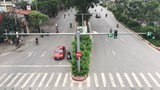 Đường phố Hà Nội vắng lặng trong ngày đầu cách ly xã hội